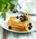 Crepes with black current Royalty Free Stock Photography