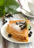 Crepes with black current stock images