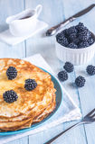 Crepes with blackberries on the wooden table Royalty Free Stock Image