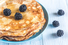Crepes with blackberries on the wooden table Stock Images