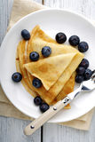 Crepes with blueberries on a plate Royalty Free Stock Photography