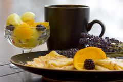Crepes and a bowl of fresh fruit Royalty Free Stock Photo