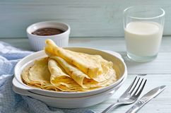 Crepes. Breakfast with french crepes on a light blue rustic desk Stock Photography