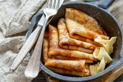 Crepes with butter sprinkled with powdered sugar. Stock Photography