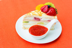 Crepes cake with orange, kiwi and strawberry sauce Stock Images