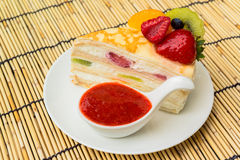 Crepes cake with orange, kiwi and strawberry sauce Royalty Free Stock Photo