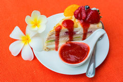 Crepes cake with orange, kiwi and strawberry sauce Stock Images