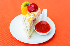 Crepes cake and strawberry sauce Royalty Free Stock Photography