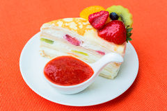 Crepes cake and strawberry sauce Stock Photo