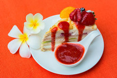 Crepes cake and strawberry sauce Stock Image
