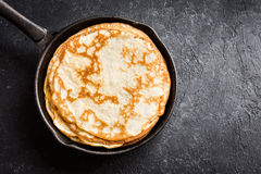 Crepes in cast iron pan Royalty Free Stock Photo