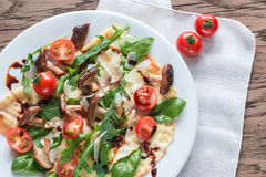 Crepes with cherry tomatoes, cheese, mushrooms and arugula Stock Photo