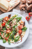 Crepes with cherry tomatoes, cheese, mushrooms and arugula Royalty Free Stock Images