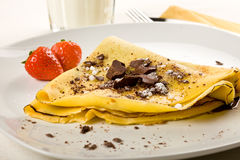 Crepes with choccolate and strawberries Royalty Free Stock Photo