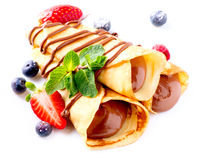 Crepes With Chocolate Cream. And Berries over white Stock Photo
