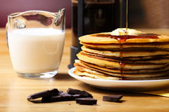 Crepes with chocolate and milk Royalty Free Stock Photography