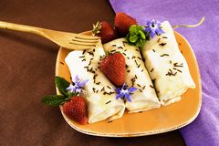 Crepes Chocolate Strawberries. Crepes On Golden Plate With Mint, Chocolate Sprinkles, Strawberries And Edible Borage Flowers Stock Photo