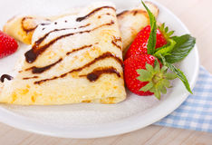 Crepes with chocolate syrup and strawberry Royalty Free Stock Photo
