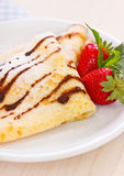 Crepes with chocolate syrup and strawberry Stock Photos