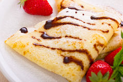 Crepes with chocolate syrup and strawberry Royalty Free Stock Photography