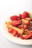 Crepes con las fresas Imagenes de archivo