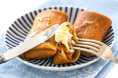 Crepes with cottage cheese and honey. Stock Photos