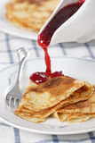 Crepes with cranberry jam Stock Photos