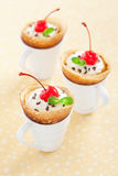 Crepes with cream. Crepes with whipped cream and cream cheese in coffee cups, selective focus Royalty Free Stock Images