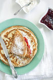 Crepes with cream cheese and strawberry jam Stock Images