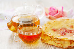 Crepes, cup of tea and rose petal jam Stock Images
