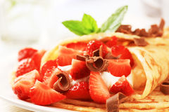 Crepes with curd cheese and strawberries Stock Images