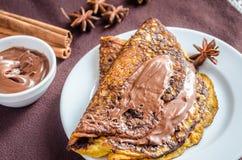 Crepes da abóbora com propagação do chocolate Imagem de Stock