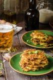 Crepes de patata con ajo y cerveza Imagen de archivo libre de regalías