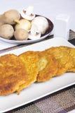 Crepes de patata con los ingredientes Fotos de archivo libres de regalías