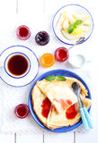 Crepes with different sorts of jam Royalty Free Stock Photos