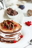 Crepes do chocolate com ameixas e chantiliy imagem de stock