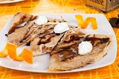 Crepes dulces con la naranja Fotos de archivo libres de regalías