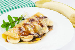 Crepes filled with chocolate, banana and coconut Stock Photo