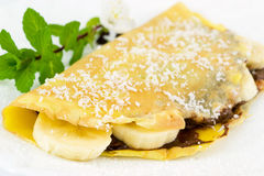 Crepes filled with chocolate, banana and coconut Royalty Free Stock Photography