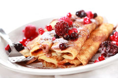 Crepes filled with chocolate and berries Royalty Free Stock Photos