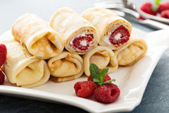 Crepes filled with cottage cheese and raspberry Royalty Free Stock Images