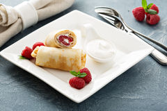 Crepes filled with cottage cheese and raspberry Stock Images