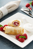 Crepes filled with cottage cheese and raspberry Royalty Free Stock Image