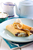 Crepes filled with cream cheese Stock Image