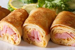 Crepes filled ham and cheese horizontal macro Stock Images