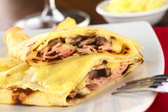 Crepes Filled with Ham, Cheese and Mushroom royalty free stock photo