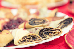 Crepes filled with poppy and raspberry syrup Stock Photography
