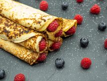 Free Crepes Filled With Jam And Fresh Raspberry And Blueberries On Slate Royalty Free Stock Photo - 178896415