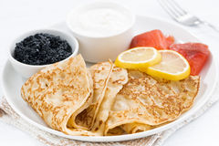 Crepes with fish, sour cream and caviar, closeup Royalty Free Stock Photography