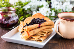 Crepes  folded in triangles with currant jam Stock Photo